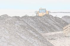 Mounds of sand being created by CAT 725 Articulated Dump Truck to help protect the beaches after Hurricane Sandy. OCNJ
