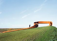 This hilltop staircase by NEXT Architects appears to create a looping path, but it's actually impossible to walk round more than once without climbing off.