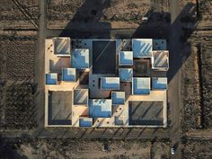 Iranian architecture firm FEA Studio designed the school for Noor E Mobin, a non-governmental organisation (NGO), as part of an educational complex in Semnan Province. School Architecture, Modern Architecture, Landscape And Urbanism, High Walls, Outdoor Learning, School Building, Sense Of Place, Primary School, School Design