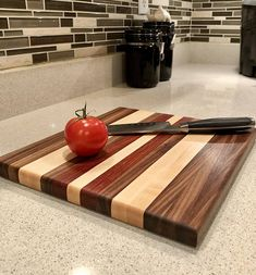This beautiful, edge-grain cutting board is made from hand selected black walnut and sugar maple, with accents of jatoba. Edges have been rounded, giving a smooth, clean appearance. Each board will be constructed 10 x 14 x 1. Rubber feet keep you safe by preventing the board from