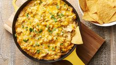 Green Chile Chicken Skillet Dip - This cheesy chicken skillet dip is flavored with green chiles and studded with sweet corn for added texture. Serve with tortilla chips for a party-perfect appetizer. Dip Recipes, Mexican Food Recipes, Chicken Recipes, Snack Recipes, Cooking Recipes, Potluck Recipes, Party Recipes, Dessert Recipes, Mexican Meals