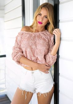 Let your sweet side shine by donning this 3D rose top.