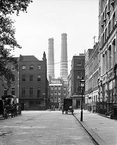A view north in Golden Square, Soho, looking towards Upper James Street, with the large chimneys of the St James' and Pall Mall Electic Light Company's works on Marshall Street in the distance. 1902