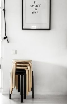 How to add colour to a monochrome home. Extra seating idea with stackable stools.