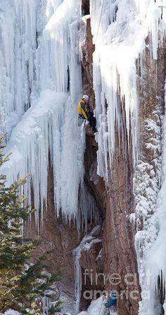 Climber on frozen falls