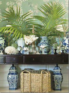 Gorgeous chinoiserie, blue & white & coral, dark wood table with seagrass baskets...love it all! This is a fabulous look!