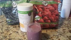 Herbalife banana caramel meal replacement smoothie with frozen blueberries and strawberries and water. Delicious!