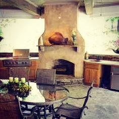 An awesome covered porch complete with a wood burning fireplace, built in gas grill & cooking station, bar sink, ice maker & sound system. Life is good! Fireplace Beam, Country Fireplace, Craftsman Fireplace, Cottage Fireplace, Fireplace Seating, Candles In Fireplace, Fireplace Garden, Paint Fireplace, Fireplace Cover