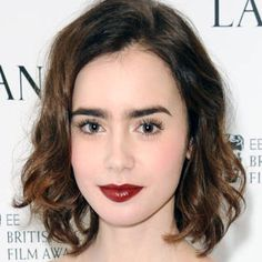 Today's beauty secret inspired by Lily Collins' deep berry lip. Click for a how-to.