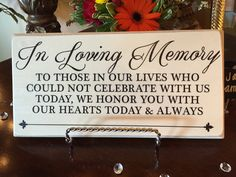 This sign was on a table with several photos of relatives who had died.