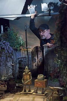 "#laika How #Boxtrolls Created One Of The Richest Worlds Of Any Animated Movie "" Director of Photography John Ashlee Prat adjusts a backlight reflection."" Credit: Jason Ptaszek / LAIKA, Inc."