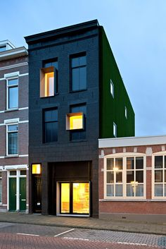 Rolf Bruggink, a Dutch designer, calls the crumbling town house he renovated in Rotterdam the Black Pearl, after the blackpainted brick facade that replaced the original one. His workshop, Studio Rolf.fr, is on the ground level.