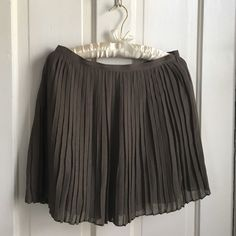J. Crew pleated mini skirt Cute and girly silk blend pleated mini in excellent condition. Side zip with hook and eye closure. Perfect with tights for a winter party! J. Crew Skirts Mini