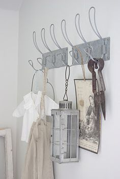 Spruce up a mudroom or front hall by hanging a lantern from your coat hangers. Worried about the fire damaging your wall and clothing? Use Candle Impressions Flameless Candles as your safe solution!