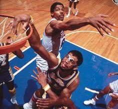 Kareem dunks past Julius Erving in 1982.