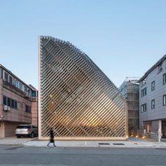 Slanted slats of aluminium cover the irregular, curving form of this house and cafe in Gyeonggi Province designed by South Korean architecture practice AND