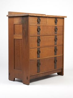 Gustav Stickley Chest of Drawers, No. 906. Circa 1910 - 1912, with ''Als Ik Kan'' over ''Stickley'' branded shop mark, also with paper label with trademark and guarantee, of oak, the outset rectangular top over two short drawers and four graduated long drawers with ''banded'' and riveted iron hardware with ring pulls, enclosed by paneled sides.