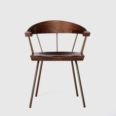 Inspired by a visit to Louis Kahn's Exeter Library - #Spindle #Chair with Brass Base in Walnut I #BassamFellows - Living Edge