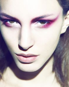 Red Sweep - Beauty shot of Kate King. A red sweep of eyeshadow for a dramatic look.