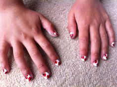 Poppy nail art on little fingers to match her party dress
