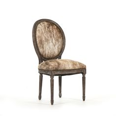 The classic Medallion Dining Chair in a fabulous cowhide! Use one as a desk chair, an accent chair or in multiples at your dining table.