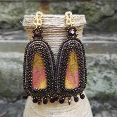 Earrings from beads with a glass cabochon