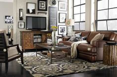 Bassett Furniture » Tools - love the configuration of pictures on the back wall