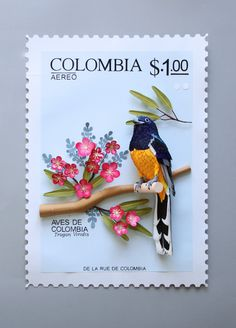 Set of 3D bird-themed stamps that were painstakingly created with colorful paper cut-outs.