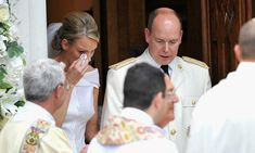 Tears of joy! The newly minted Monaco princes dabbed her eyes as she and Albert left the Sainte Devote church after their religious wedding ceremony held at the Prince's Palace.