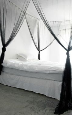 = sheer black bed net and white
