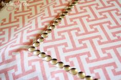 tutorial: fabric-covered corkboard with a faux nail head trim using thumbtacks