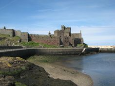 Isle of Man is an island in British Isles in Irish Sea and it is tucked in between islands of Ir. Places Around The World, Around The Worlds, Irish Sea, Kingdom Of Great Britain, Viking Age, Guy Pictures, Places To Visit, England, History