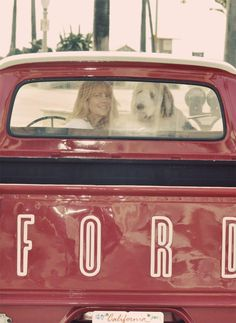 A girl, her Ford Truck and her dog