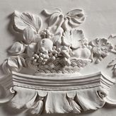 Lot 18 Geoffrey Preston, Fruit Basket (2012), bas-relief sculpture, Modelled in clay and cast in plaster, 12 x 10 in