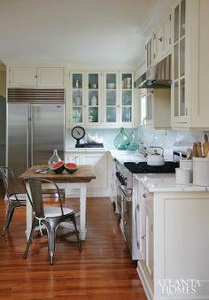 Atlanta Homes & Lifestyles - kitchens - Tolix Chair, l-shaped kitchen, hardwood floors, white cabinets, white cabinetry, white kitchen cabin...