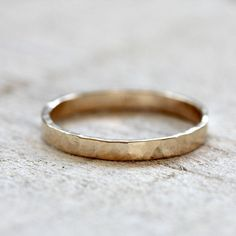 Hammered ring made from solid 14k gold. This thin and simple 14k gold has a unique hammered band. A great 14k gold wedding ring or an everyday ring. The ring measures about 2.2mm high and 1mm thick. E