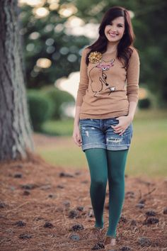 Foxy ---- oxfords, green tights, jean shorts, tan graphic sweater. Such a sweet, casual outfit.