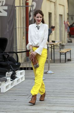 Julia Malik in yellow pants