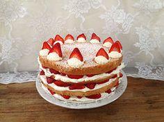 Little Miss Sunshine - lemon sponge cake filled with whipped cream and organic strawberries topped with dollops of whipped cream and strawberry slices