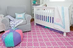 Monogrammed bedding is a sweet way to personalize a room. Take milestone pictures of baby on the quilt next to her initials to see how fast she is growing up.