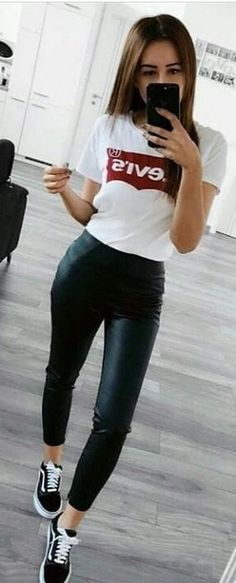 #spring #outfits woman wearing white Levis T-shirt and black leather leggings. Pic by @newoutfitters