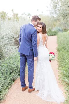 Stunning winter wedding at the gorgeous El Chorro Resort. This wedding with its rich burgundy, deep fuchsia, and navy blues, was the perfect color pallet for the season.  The florals included soft greens, succulents, and huge white peonies.