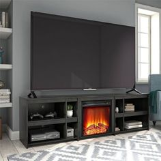 Finish your living room or man cave with the classic Ameriwood Home Glenco Fireplace TV Stand. This simple TV Stand can accommodate most TVs up to 70 in. W or up to 120 lbs. The black oak woodgrain finish Large Shelves, Tv Over Fireplace, Home, Fireplace Tv, Tv Decor, Fireplace Tv Stand, Simple Tv Stand, Fireplace, Fireplace Makeover