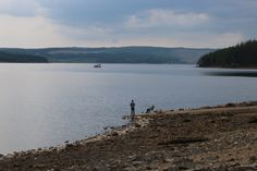 Fishermen on Keilder Water with The Osprey Ferry in the distance  - Photography by Jonathan Webb