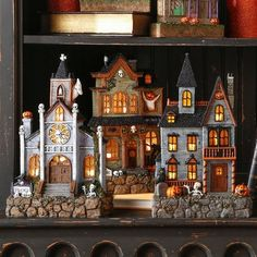 Transform your cabinet area or tabletop into a spooky village! These lighted houses will give you the ultimate just out of Halloween Town feel! Each house has it's own character! With little ghouls, creepy skeletons, smiling pumpkins, and black cats peeping out from around corners and windows, there's so much to look at on these detailed buildings! Add in some bottle brush trees and some spider webs to pull your little town together! This set includes two house and a church! Requires ...