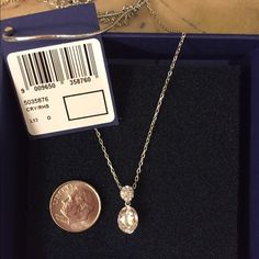Swarovski Necklace, Brand New Swarovski Necklace. Hangs 8 inches. Brand new and comes with tags and box. Swarovski Jewelry Necklaces