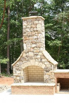 I like a fireplace sitting on a brick base especially if it is stone sitting on a stone patio.....breaks up all the stone.