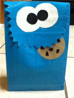 Cookie Monster Lunch Bag made from duck tape!! A little bit of a challenge, but doable (hard to find black duct tape) I believe this could be a great Valentine's Box with a few adjustments.