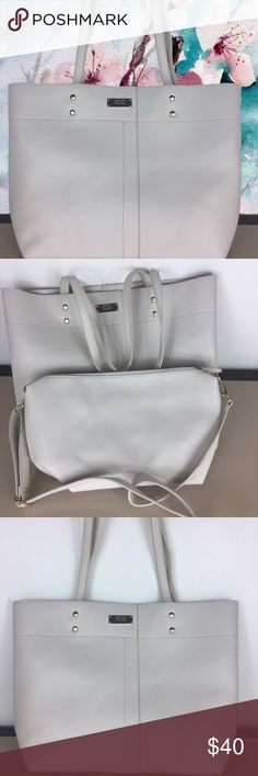 BCBG Paris Textured Tote set of 2 BCBG Paris textured Tote set of 2 New tags was lost.Includes tote and pouch Tote: 11.5'' W x 16.5'' H x 4.5'' D Pouch/Bag: 14'' W x 7.5'' H x 4.25'' D 10'' handle drop 50'' max. strap length Outer: man-made Lining: polyester Zip closure Interior: one zip and two slip pockets and center divider Exterior: one zip pocket Removable crossbody strap BCBG Bags