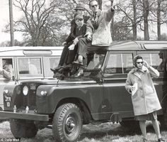 Family: The Queen leans against a Land Rover at the Badminton horse trials in 1969, while the Duke of Edinburgh sits on the roof with Princess Anne and Prince Andrew